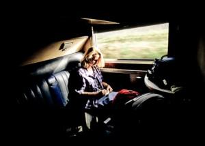 Woman writing notes while on train from Nairobi to Mombasa, Kenya, Africa